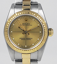 Ladies Rolex Oyster Perpetual 18K/SS Champagne Zephyr Dial 76243